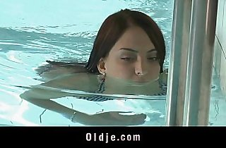 Sweet redhead sucking cock at the pool